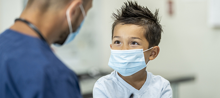 Young boy wearing a mask at a doctors appointment