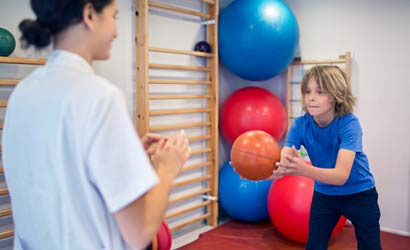 Adolescent boy in physical therapy