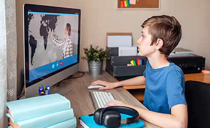 Boy participating in virtual learning.