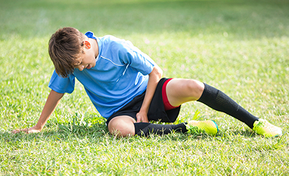 Injured teenage soccer player.