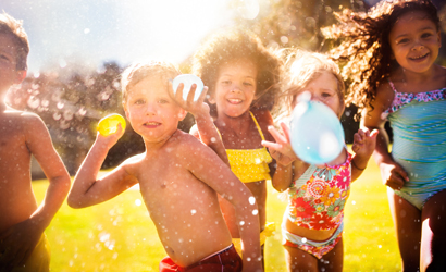 Group of children throwing water balloons