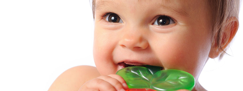 Close up of a baby chewing on a teething ring