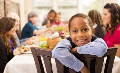 Close up of a child smiling at the dinner table