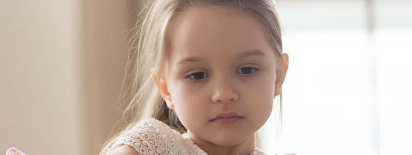 Close up of a young girl with a concerned look on her face