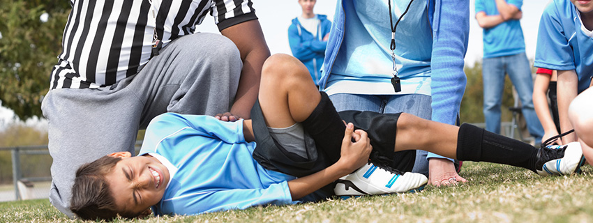 Young soccer player injured on the field