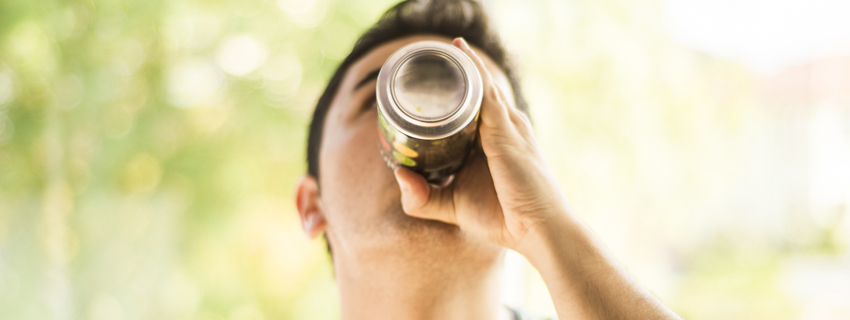Close up of a teen drinking an energy drink
