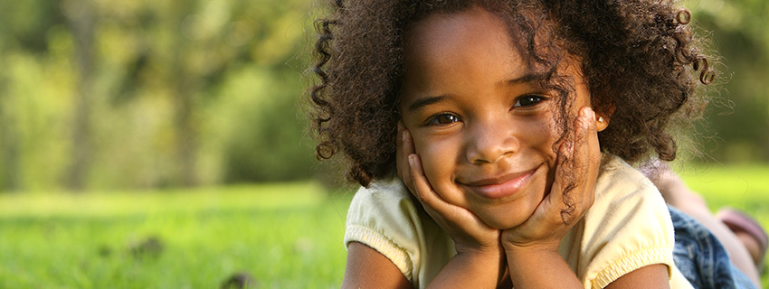 Close up of child smiling in a park