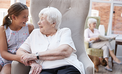 Child visiting an elderly person in a nursing home