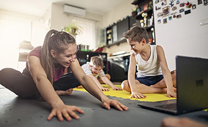 Kids stretching at home during the COVID-19 pandemic