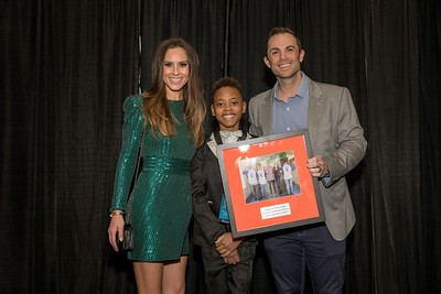 CHKD patient Tymiere Grayson presents David Wright and his wife, Molly Beers, a gift of appreciation for a decade of hosting Wright Night for CHKD.